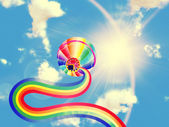 Hot air balloon with rainbow — Stock Photo