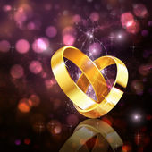 Romantic background with wedding rings — Stock Photo