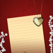 Heart pendant and pearls — Stock Photo