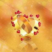 Wedding rings on yellow background — Stock Photo