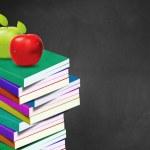 Blackboard and books — Stock Photo