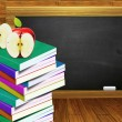 School books and blackboard — Stock Photo #30420291