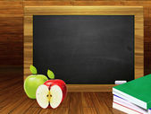 School books and blackboard — Stock Photo