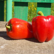 Two red peppers on table — Stock Photo #30908861