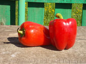Two red peppers on table — Stock Photo