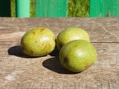 Green walnuts on table — Stock Photo
