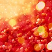 Blurry hearts background — Stockfoto