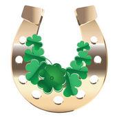 Gold horseshoe with clover — Stock vektor