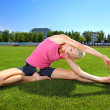 Woman  stretching after workout — Stock Photo