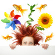 Scared woman with different object  on her head - Stock Photo