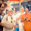 Unidentified members of Hare Krishna chanting and dancing — Stock Photo #12887668