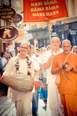 Unidentified members of Hare Krishna chanting and dancing — Stock Photo
