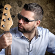 Bass player with glasses — Stock Photo