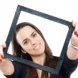 Woman with a frame — Stock Photo