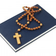 Holy Bible and rosary breads — Stock Photo