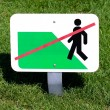 Sign of forbidden walk on grass — Stock Photo