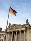Reichstag in Berlin wih German flag — Stock Photo