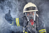 Firewoman in fire protection suit — Stock Photo