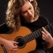 Beautiful young female guitar player — Stock Photo