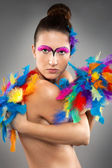Beautiful young female model with bold make-up — Stock Photo