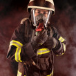 Stock Photo: Firefighter in protective gear
