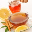 Tea with honey, lemon and cinnamon — Stock Photo