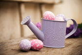 Easter eggs in watering can — Stock Photo