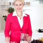 Businesswoman preparing breakfast  — Stock Photo #49797835