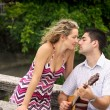 Man playing guitar for his woman — Stock Photo #49808261