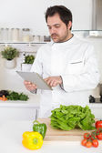 Chef with tablet — Stock Photo