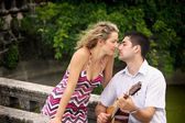 Man playing guitar for his woman — Stock Photo