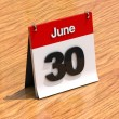 Calendar on desk - June 30th - Stock Photo