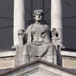 Lady Justice atop a Court Building - Stock Photo