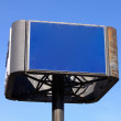Blue Sign before a Cloudless Sky Facing Right — Stock Photo