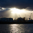 Sun Shining through Clouds over the Harbor — Stock Photo