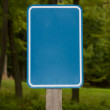 Empty Blue Sign in Woods — Stock Photo