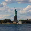 Statue of Liberty with Sailboat — Stock Photo #25321085