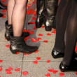 Women Standing on Rose Petals — Stock Photo