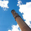 Stock Photo: Smoke Stack Rises into Blue Sky