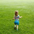 Young child running through a meadow — Stock Photo