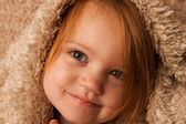 Small child smirking with blanket — Stock Photo