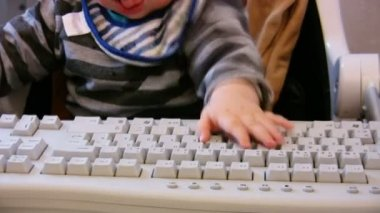 Baby typing on computer keyboard 2 — Stock Video