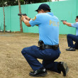 Asian police firearm shooting practice - Stock Photo