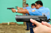Asian police firearm shooting practice — Stock Photo