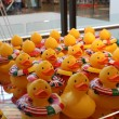 Постер, плакат: Yellow Rubber Ducks with Flags of different countries