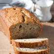 Delicious freshly baked banana bread on wooden board — Stock Photo #12036971