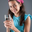 Young girl with a glass of water, concept of healthy lifestyle — Stock Photo