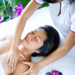 Young woman having body massage from therapist — Stock Photo