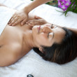Young woman recieving body massage from therapist — Stock Photo