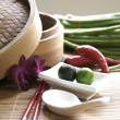 Chinese cooking set with oriental ingredients of long beans, chili and local limes. — Stock Photo #12038307